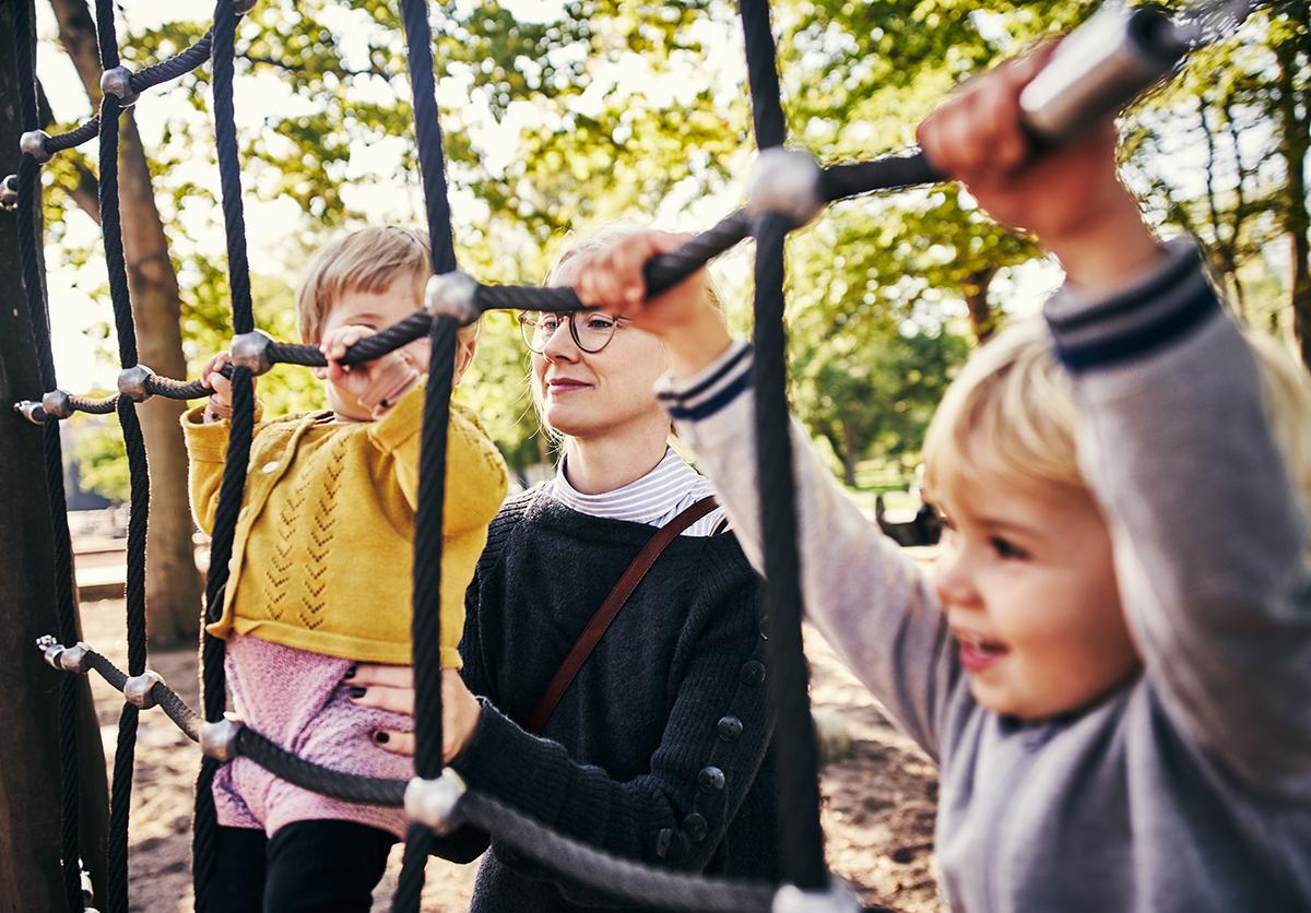 Parent with children on playground