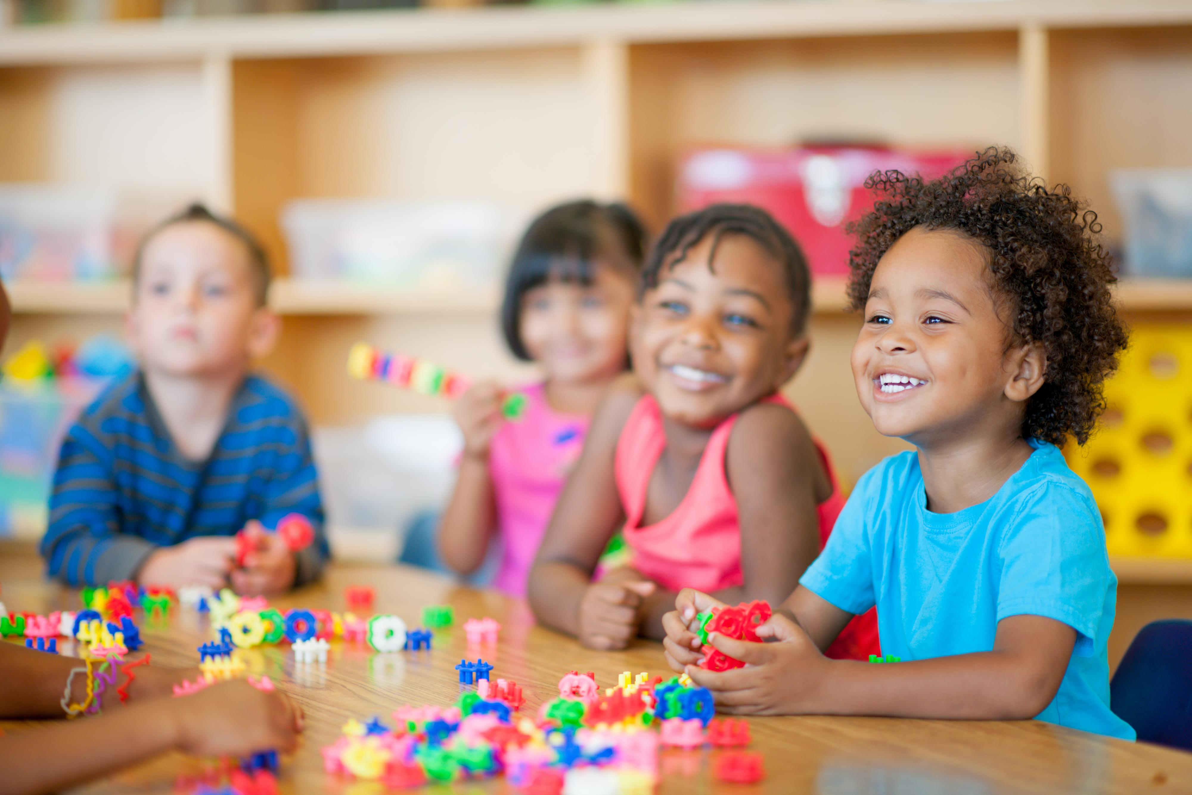 Children extend their curiosity as they play with manipulatives.