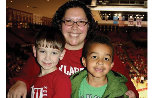 Francisca Jensen with two of her students at a basketball game