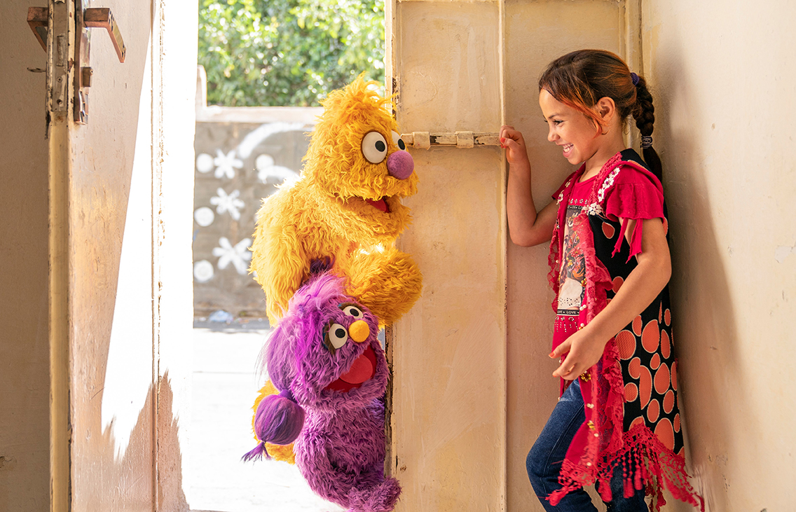 young Syrian girl with Muppets