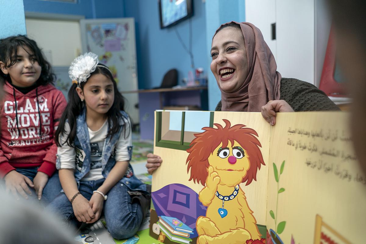 Syrian teacher with students