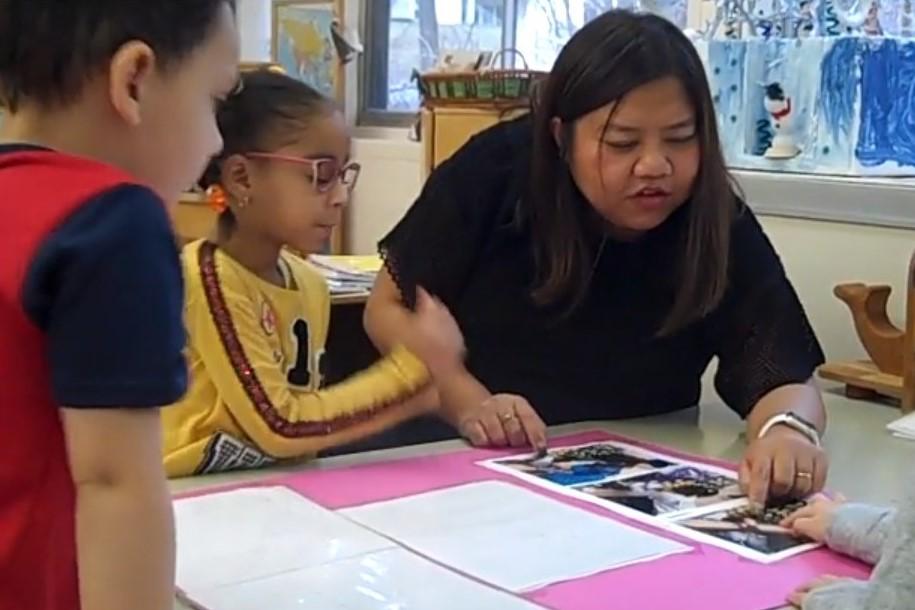 Suchira, a teacher in a Head Start program, works with a small group of children.