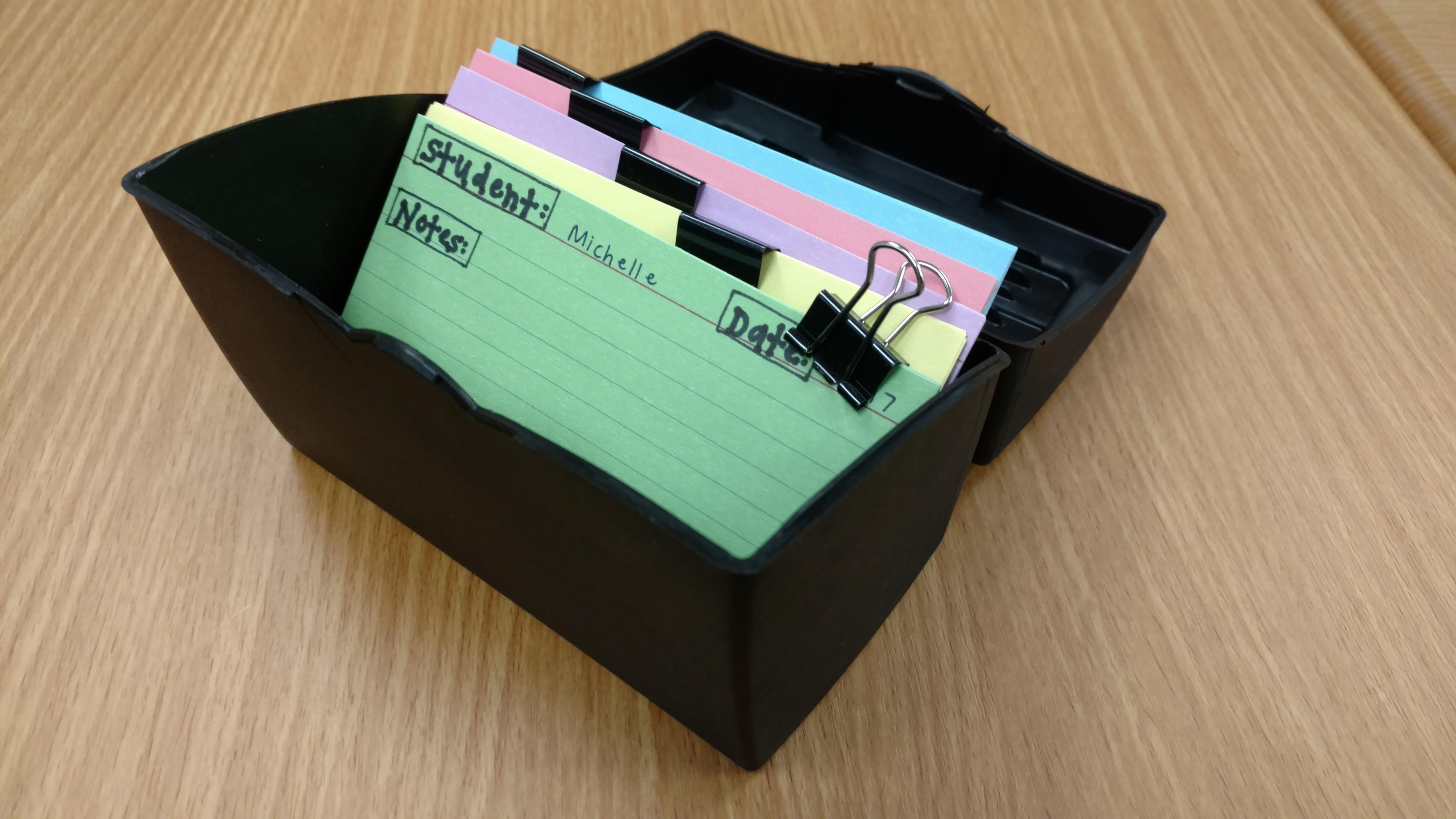 Colored index cards held together with binder clips