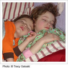 Two kids sleeping next to each other