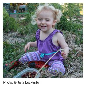 Girl in a vegetable garden