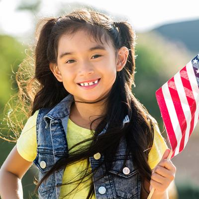 young girl with american flag