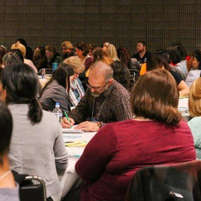 NAEYC conference attendees participating in a session.