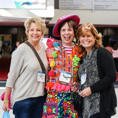 Three female educators pose for a picture during the 2018 Annual Conference
