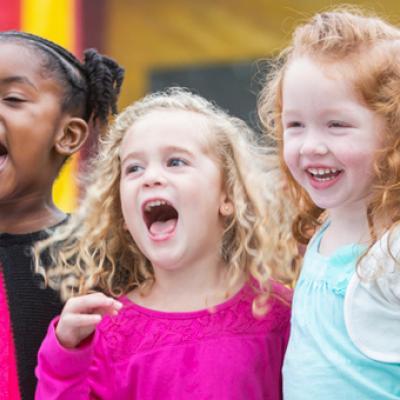 Group of preschoolers singing.