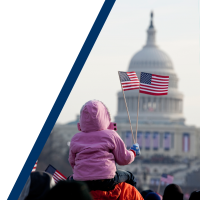 child waving flag infront of the US capitol building