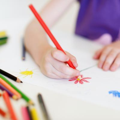 Child drawing a flower