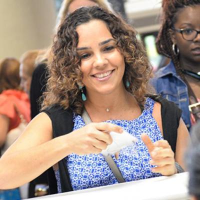 Woman handing paper across a counter