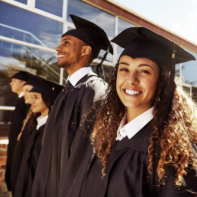 College graduates standing in caps and gowns