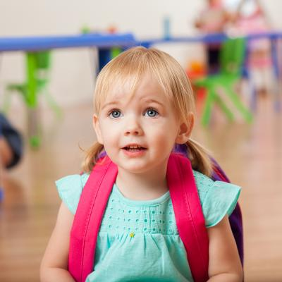 preschool girl with backpack