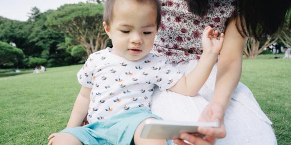 Baby looking at camera phone