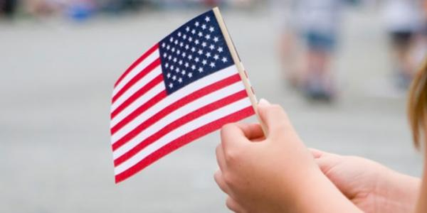 a child holding an American flag
