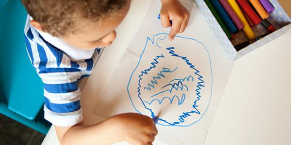 Boy drawing artwork