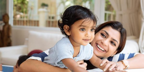 Toddler and mother smiling