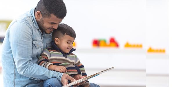 A parent reading with a child.