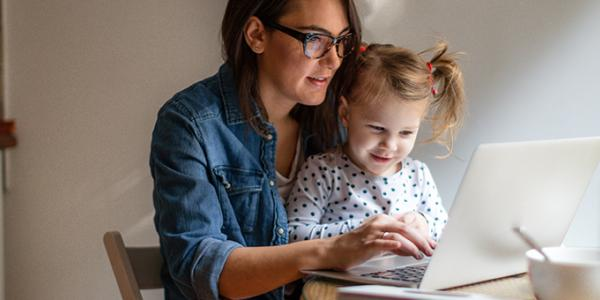 Mother and daughter looking at a digital tablet