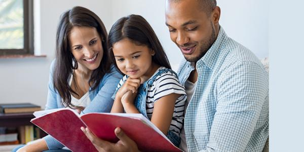 Mother, Father and Daughter reading