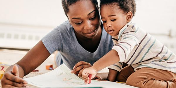 Toddler and mother reading a book