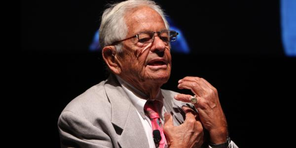 Dr. T. Berry Brazelton speaking at a conference.