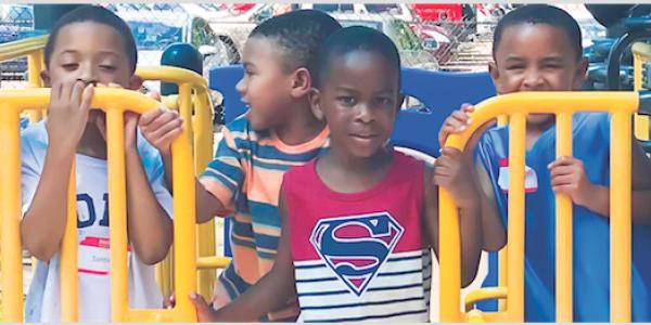 Four boys on playground