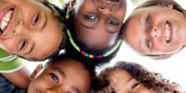 Four diverse children in circle