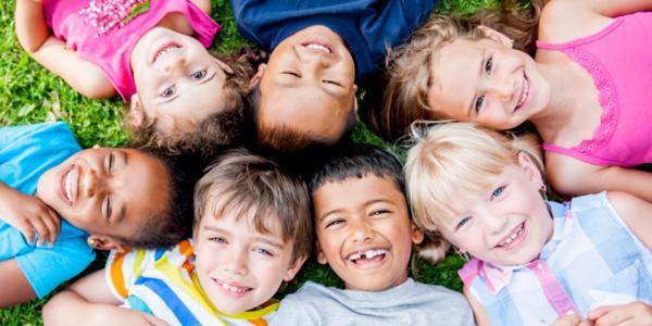 Seven children in the grass