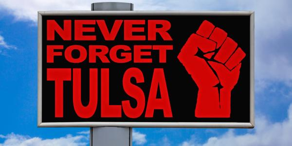 """a sign that says """"never forget tulsa"""""""