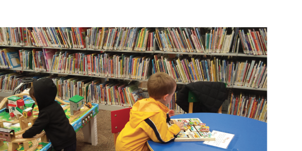 Children playing in play centers at a library
