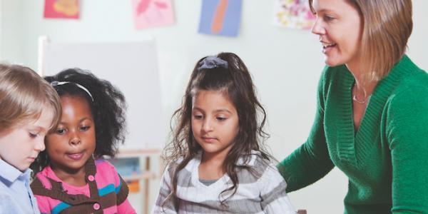 Teacher observing three students