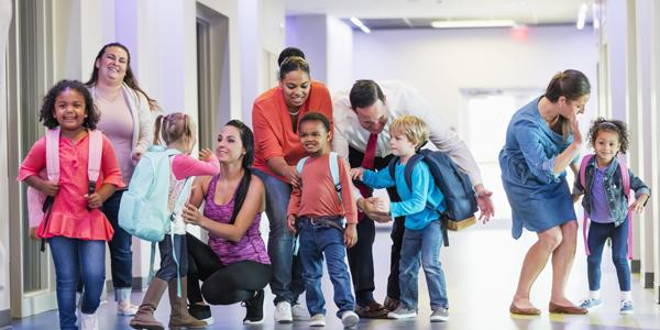 Young children leaving their teachers and classrooms