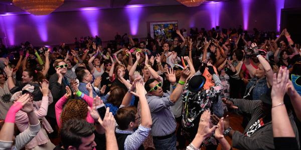 Annual Conference attendees dancing during a celebration.