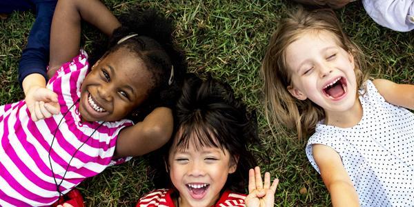 Children playing in grass
