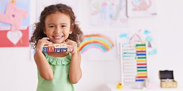 Girl smiling with toys