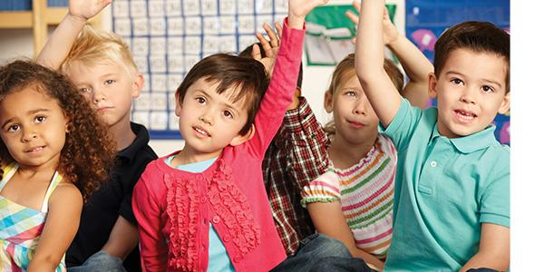 a group students raising their hands