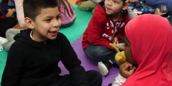 Children talking in classroom