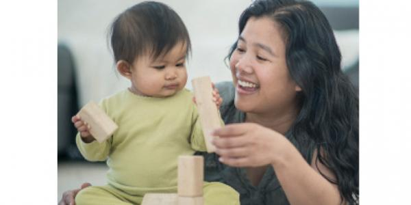 Infant and mother playing with blocks