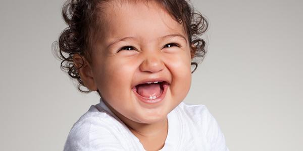 Infant smiling and laughing