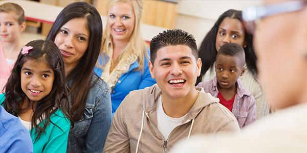 Diverse classroom with parents and children