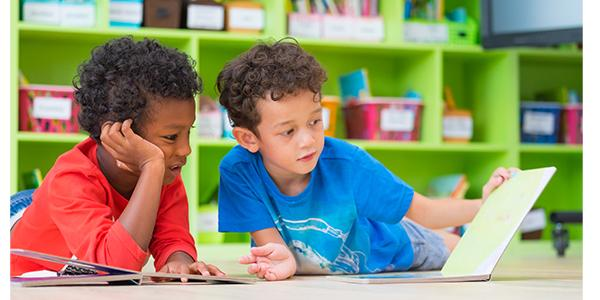 Two children reading on the floor