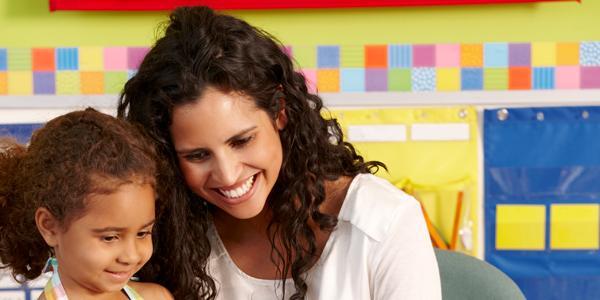 Teacher and preschool girl in a classroom