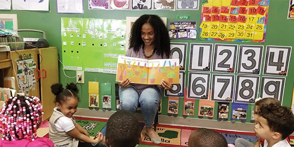 Jennifer Scott in her pre-K classroom, reading to hear students