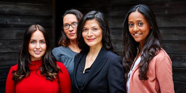 Five women standing outside