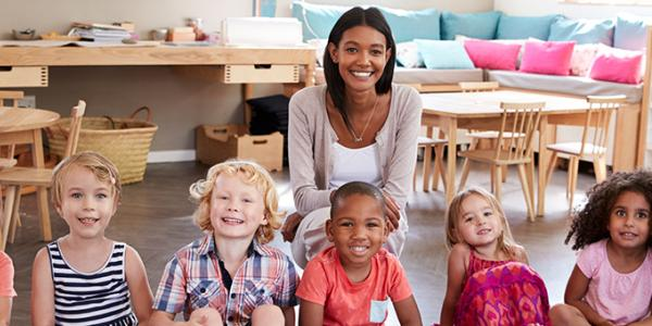 educator in an early learning program with children