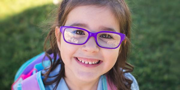 Girl in glasses wearing a bookbag