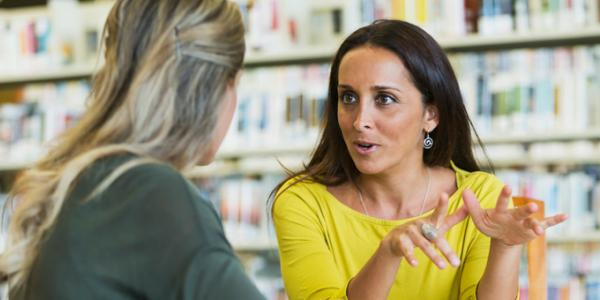 Two teachers talking together.