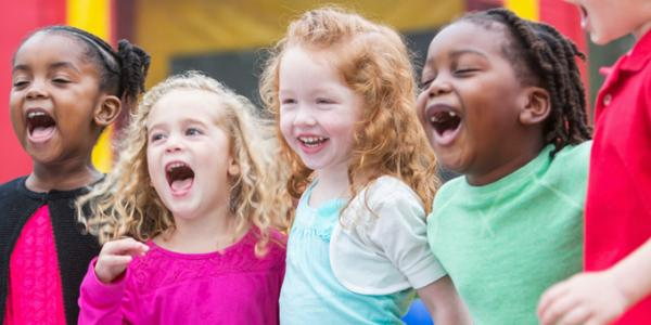 Preschoolers singing and laughing